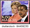 MALAWI - CIRCA 2008: A stamp printed in Malawi shows the 44th President of United States of America, Barack Obama with Hillary Clinton, circa 2008 - stock photo