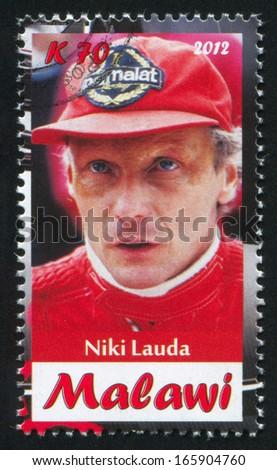 Malawi - CIRCA 2012: stamp printed by Malawi, shows Niki Lauda, circa 2012 - stock photo