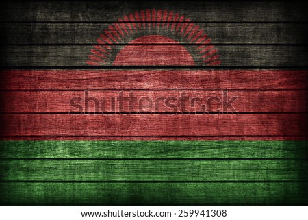 Malawi flag pattern on wooden board texture ,retro vintage style - stock photo