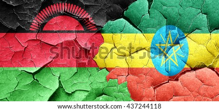 Malawi flag with Ethiopia flag on a grunge cracked wall - stock photo