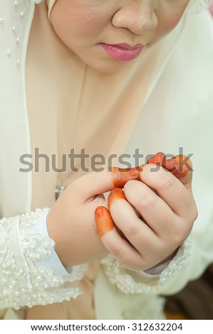 Malay bride doing prayer beautiful and unique. Selective focus.