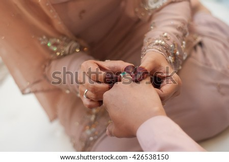 Malay Couple Wearing A Wedding Ring. Selective Focus And Shallow DOF.