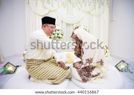Malay Wedding Couple during the marriage ceremony. Selective Focus. Tones Image.