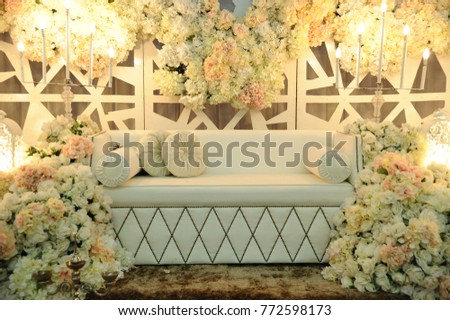 Malay Wedding Dais Or Pelamin In Malaysia With Fresh Flower Decoration Where Newlywed Sit On For