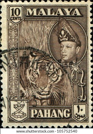 MALAYA - CIRCA 1957-61: A stamp printed in state of Pahang in the East Coast Region of Malaya shows tiger and Sultan Abu Bakar, series, circa 1957-61