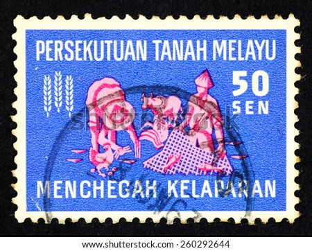 MALAYA - CIRCA 1963: Blue color postage stamp printed in Federation of Malaya with illustrative image of farmer  and fisherman to commemorate hunger prevention. - stock photo
