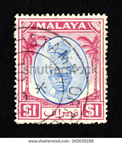 MALAYA - CIRCA 1952: Pink color postage stamp printed in Federation of Malaya with illustrative portrait image of Perak state Sultan Yussuf Izzudin Shah. - stock photo