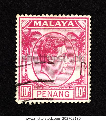 MALAYA - CIRCA 1938: Pink color postage stamp printed in Malaya Penang with portrait image of King George VI. - stock photo