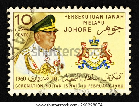MALAYA - CIRCA 1960: Postage stamp printed in Johore (Federation of Malaya) with portrait of Sultan Ismail Ibni Al-Marhum Sultan Ibrahim Al-Masyhur to commemorate his coronation on 10 February 1960. - stock photo