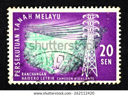 MALAYA - CIRCA 1963: Purple color postage stamp printed in Federation of Malaya with illustrative image of the Cameron Highlands hydro electric dam and power pylon. - stock photo