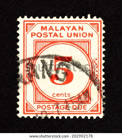 MALAYA - CIRCA 1951: Red color postage due stamp printed in Malaya for the Malayan Postal Union with a value of 5 cents. - stock photo