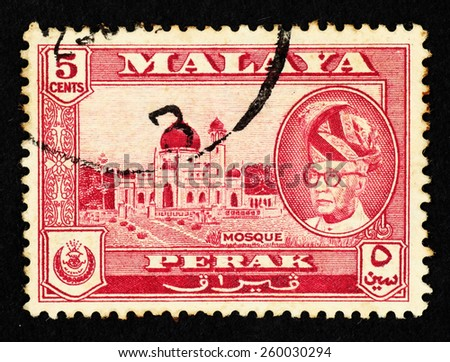 MALAYA - CIRCA 1957: Red color postage stamp printed in Perak (Federation of Malaya) with illustrative image of a mosque and portrait of Sultan Yussuf Izzuddin Shah. - stock photo