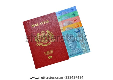 Malaysia banknotes with Malaysia Passport over withe background. - stock photo