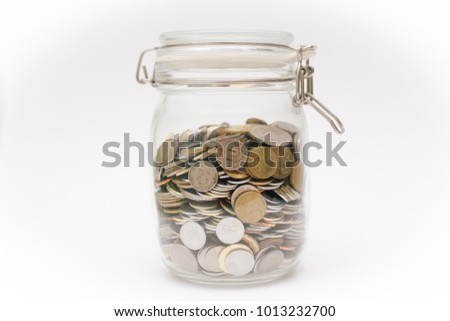Malaysia cents coin inside a glass container isolated on white background