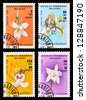 MALAYSIA - CIRCA 1988: A set of postage stamps printed in MALAYSIA shows flowers, series, circa 1988 - stock photo