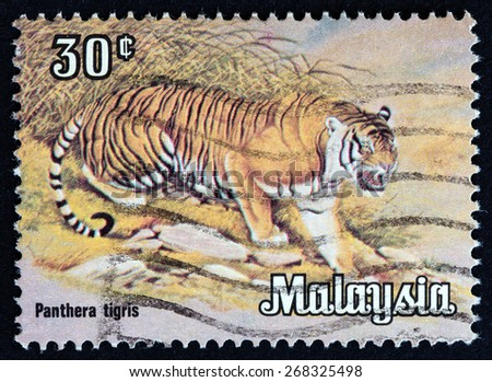 """MALAYSIA - CIRCA 1979: A stamp printed in Malaysia from the """"Animals """" issue shows a Tiger (Panthera tigris), circa 1979. - stock photo"""