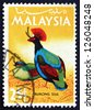 MALAYSIA - CIRCA 1965: a stamp printed in Malaysia shows Crested Wood Partridge, Rollulus Rouloul, Bird, circa 1965 - stock photo