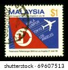 MALAYSIA - CIRCA 1986: A stamp printed in MALAYSIA shows image of the Malaysia Airlines System Berhad , DBA Malaysia Airlines (abbreviated MAS), is the government-owned flag carrier of Malaysia circa 1986 - stock photo