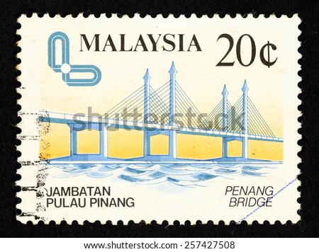 MALAYSIA - CIRCA 1985: Postage stamp printed in Malaysia with an illustrative image of the Penang Bridge.