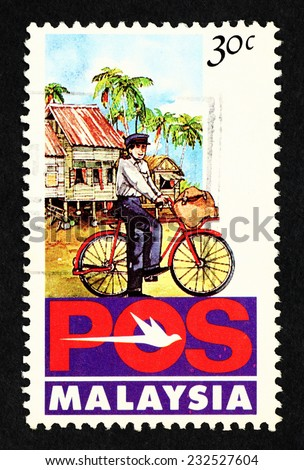 MALAYSIA - CIRCA 1992: Postage stamp printed in Malaysia with caricature image of Pos Malaysia postman on a postal delivery bicycle. - stock photo