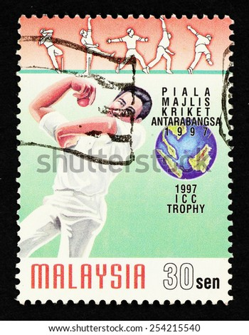 MALAYSIA - CIRCA 1997: Postage stamp printed in Malaysia with image of a cricket sportsman to commemorate the International Cricket Council (ICC) Trophy 1997 held in Kuala Lumpur. - stock photo