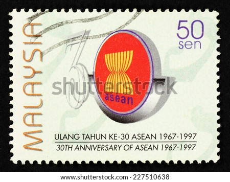 MALAYSIA - CIRCA 1997: Postage stamp printed in Malaysia with image of Association of South East Asian Nation (ASEAN) emblem to commemorate 30th Anniversary of ASEAN. - stock photo