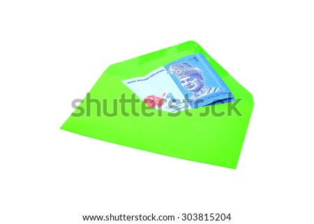 Malaysia Currency in envelope on a white background.