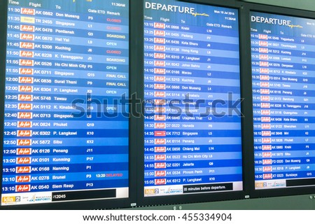 MALAYSIA - 18 JULY 2016 - AirAsia flight boarding table in Kuala Lumpur International Airport 2. AirAsia airlines is one of famous low-cost airlines among tourist and it base at KLIA 2. - stock photo