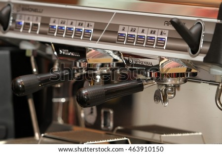 "MALAYSIA, KUALA LUMPUR 05 AUGUST 2016 - An espresso machine brews coffee by forcing pressurized water near boiling point through a ""puck"" of ground coffee and a filter in order to produce espresso."