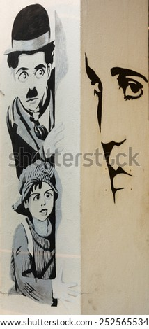 MALAYSIA, PENANG, GEORGETOWN - CIRCA JUL 2014: Cartoon style black and white mural of Charlie Chaplain and other historical celebrities is painted on the walls of a local building. - stock photo