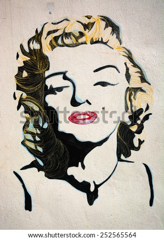 MALAYSIA, PENANG, GEORGETOWN - CIRCA JUL 2014: Lifesize painted mural featuring an iconic image of Marilyn Monroe in color. - stock photo