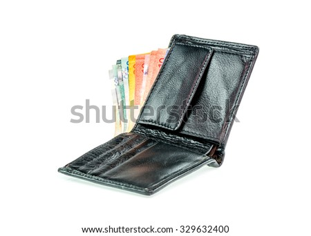 Malaysia ringkit in leather wallet on white background - stock photo