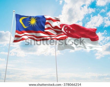 Malaysia & Singapore Flags are waving in the sky - stock photo