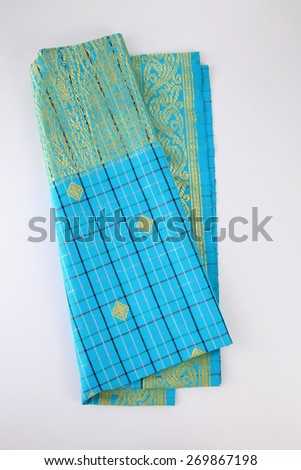 Malaysia Songket .Songket is a fabric that belongs to the brocade family of textiles of Indonesia, Malaysia and Brunei. It is hand-woven in silk or cotton - stock photo