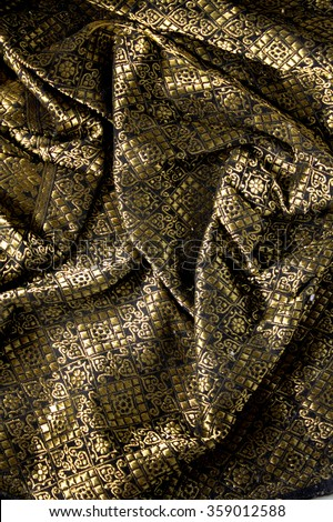 Malaysia Songket .Songket is a fabric that belongs to the brocade family of textiles of Indonesia, Malaysia and Brunei. It is hand-woven in silk or cotton. - stock photo