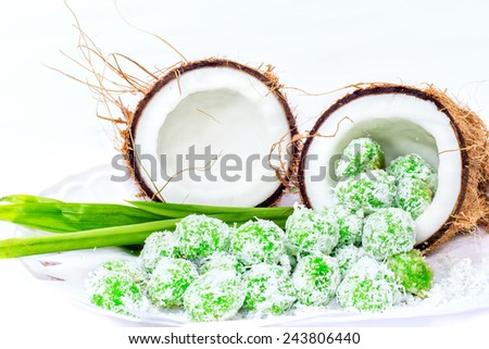 Malaysia traditional food with white background, name is Ondeh - Ondeh. Image has grain or noise and soft focus when view at full resolution. (Shallow DOF, slight motion blur ) - stock photo