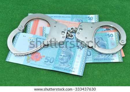 Malaysian banknotes with shackle - stock photo