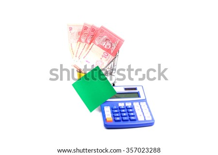 Malaysian currency. Ten ringgit in shopping trolleys on a white background. - stock photo