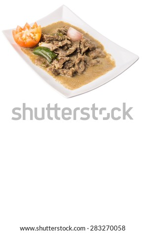 Malaysian dish of beef korma on white plate