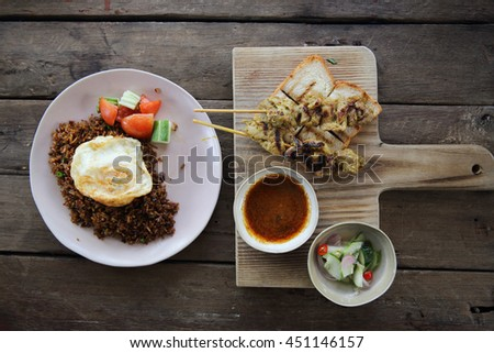 Malaysian food chicken satay with peanut sauce on wood background
