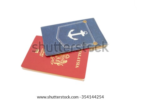 Malaysian passport with cover isolated on white background