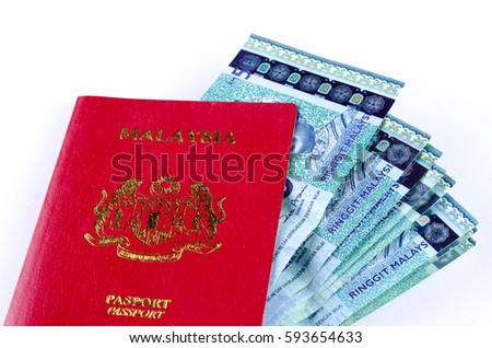 Malaysian Passport with Money over white background