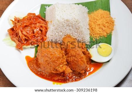 Malaysian rice dish, chicken curry rice - stock photo