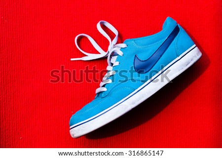 MALAYSIAN - SEPTEMBER 12 , 2015 : Nike shoes with red background and this photo in available light. This photo taken on september 12 , 2015 in malaysian.