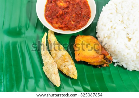 Malaysian traditional food Nasi Lemak served with spicy shrimp g - stock photo