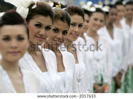 Malaysian women wearing traditional dress, 2006. - stock photo