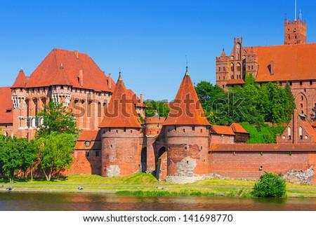 Malbork castle in summer scenery, Poland - stock photo
