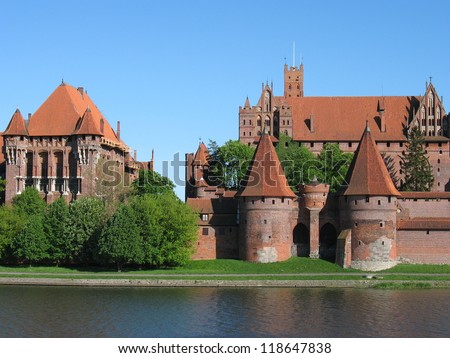 Malbork medieval castle view across river - stock photo