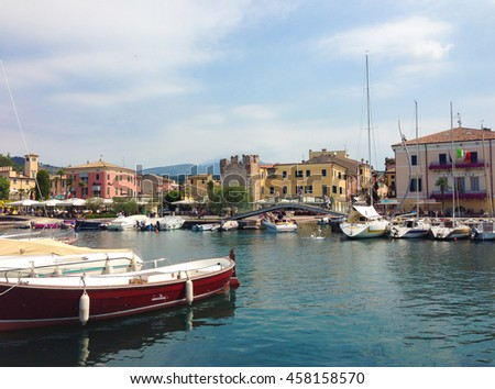 MALCESINE, ITALY - JUNE 26, 2015: Boats in the harbor of Malcesine on Garda lake
