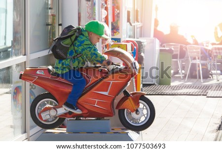 Malcesine, Italy - September 19, 2013: Boy on the bike attraction in cafe in Malcesine